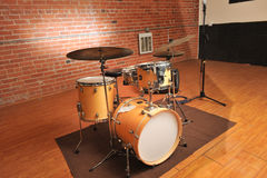 Set of drums in a brick and wood studio Royalty Free Stock Photo