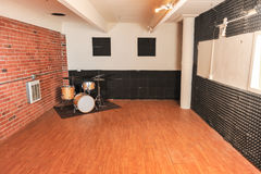 Set of drums in a brick and wood studio Royalty Free Stock Photos