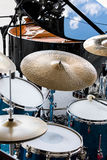 Set of drums, microphones and wires on stage before performance Royalty Free Stock Image