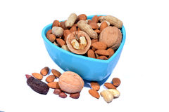 Set of Dry Fruits in a Heart Shape Bowl Royalty Free Stock Photography