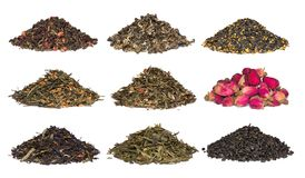 A set of dry herbal and floral tea. Green, black, composition teas on white. A set of dry herbal and floral tea. Green, black, composition teas isolated on white royalty free stock images