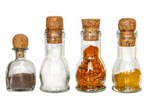 set of dry spices in vintage glass bottles with old wine corc Royalty Free Stock Photos