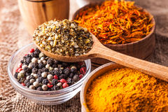 Set dry spices in a wooden and glass bowls close-up Royalty Free Stock Photo