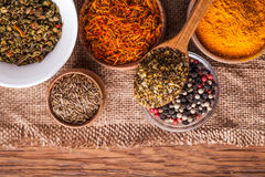 Set dry spices in a wooden and glass bowls Stock Photography