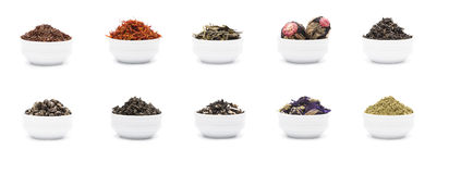 Set of dry tea leaves in white porcelain bowls Stock Photography