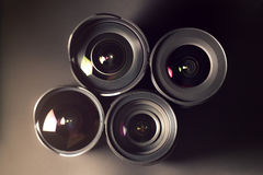 Set of DSLR lenses, different sizes and. Reflections Stock Images