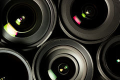 Set of DSLR lenses, different sizes and. Reflections. Low key image Stock Photo