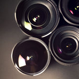 Set of DSLR lenses, different types and. Set of DSLR lenses, different sizes and reflections Royalty Free Stock Images