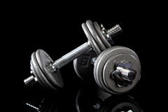 Set of dumbells on black Royalty Free Stock Images