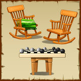 Set dwa kołysają krzesła z warcabami na drewnianym Obrazy Stock
