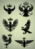 Set of eagle and crown. Set of heraldry eagle and crown design elements,black colored Royalty Free Stock Photography