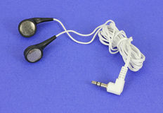 Set of ear buds on blue background Stock Photos
