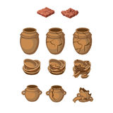 Set of earthenware jugs and plates, whole, broken. Set of eleven earthenware jugs and plates, whole and broken items Stock Photos