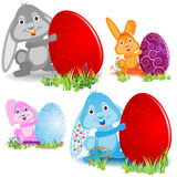 Set of easter bunnies. And eggs Royalty Free Stock Images