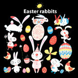 Set of Easter bunnies and eggs o. Funny set of Easter bunnies and eggs on a dark background royalty free illustration