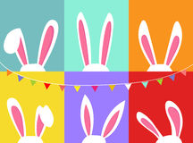 Set of easter bunny ears, with party flag bunting, colorful background Royalty Free Stock Photography