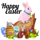 Set of easter chocolate egg hunt bunny basket on green grass decorated flowers, rabbit happy spring season holiday Stock Photo