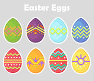 Set of Easter eggs, colored, oval, bright with a white outline isolated on a gray background. Spring holiday. Vector Illustration. Stock Images