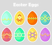 Set of Easter eggs icon, colored, oval, bright with a white outline isolated on a gray background. Royalty Free Stock Photography