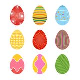 Set of spring colored easter eggs with dots and lines. Set of easter eggs in soft spring colors having patterns of lines, leaves and snowflakes Royalty Free Stock Photos