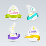 Set of easter labels in the form of bunnies and eggs with colored curled ribbons. Royalty Free Stock Photo