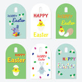 Set of Easter tags. Set of Easter gift tags with bunny, bird, flowes, chickens and Easter eggs. Holiday illustrations and wishes for design and greetings with Stock Photos