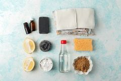 Set of eco-friendly natural cleaning products on wooden kitchen table: mustard, soda, essential oils, cellulose sponge, rags, royalty free stock photos
