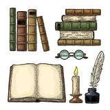 Set education. Inkwell with feather, pile books, glasses, candle. Set education. Inkwell with feather, pile of old books, glasses, candle. Isolated on white Stock Photo