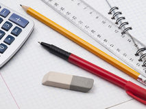 Set of educatoins tools. Protractor, pen, pencil, rules, calculator and workbook page Royalty Free Stock Images