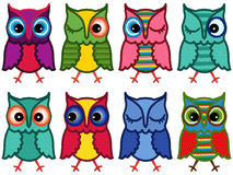 Set of eight amusing motley owls Royalty Free Stock Image