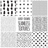 Set of eight black and white seamless hand drawn Stock Image