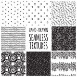 Set of eight black and white seamless hand drawn Royalty Free Stock Images