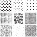 Set of eight black and white seamless hand drawn Royalty Free Stock Photography