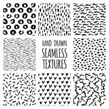 Set of eight black and white seamless hand drawn textures Stock Image