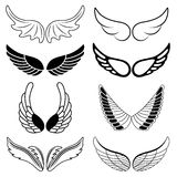Set of eight black and white silhouettes of wings Stock Images