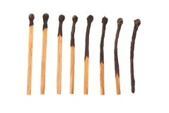 Set of eight burnt wooden matches arranged in ascending order Stock Photos