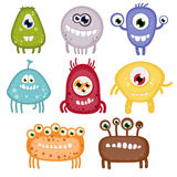 Set of eight funny toothy monsters. Royalty Free Stock Photos