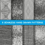 Seamless hand drawn patterns. Set of eight hand drawn graphic patterns. Cute sketched backgrounds. Seamless doodle texture. Made in vector Vector Illustration