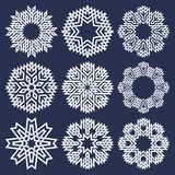 Set of eight pointed circular patterns in Oriental intersecting lines style. Nine white mandalas in snowflakes form on blue backgr. Ound royalty free illustration