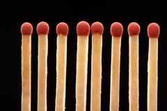 Set of eight red wooden matches on black background. Set of eight red wooden matches isolated on black background Royalty Free Stock Photos