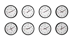 Set of eight round black color wall world clocks royalty free stock image