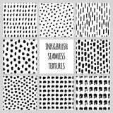 Set of eight seamless black and white vector free hand doodle textures, dry brush ink art. Stock Photos