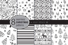 Set of eight seamless hand drawn christmas patterns. Royalty Free Stock Images