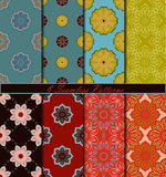 Set of eight seamless pattern with mandalas in bright beautiful colors. Vector background Royalty Free Stock Images