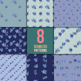 Set of eight seamless patterns with blue flowers Stock Image