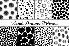 Set of eight seamless textures. Patterns with spheres, round and oval elements and spots. Abstract forms drawn a wide pen and ink. Backgrounds in black and Stock Image