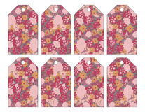 Set of eight shabby chic grungy floral tags stock illustration