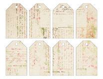 Set of eight shabby chic grungy vintage Christmas tags with antique handwriting stock illustration