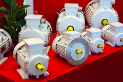 The set of electric motors. A set of electric motors on the red background Royalty Free Stock Photography