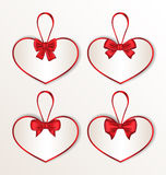 Set elegance cards heart shaped with silk bows for Royalty Free Stock Photo